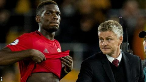 Paul Pogba (left) and Manchester United manager Ole Gunnar Solksjaer