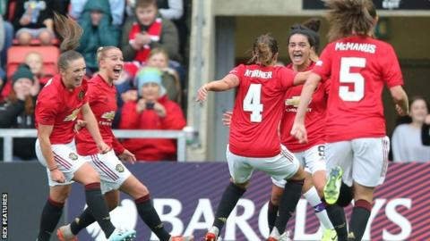 Jess Sigsworth (second from right) celebrates scoring Manchester United's second goal in the victory over their derby rivals