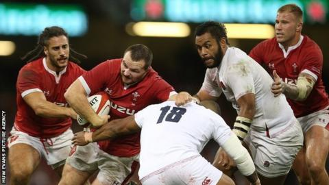 Ken Owens takes on England for Wales, supported by Josh Navidi and Ross Moriarty