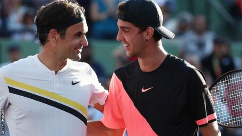 Kokkinakis (right) beats Federer