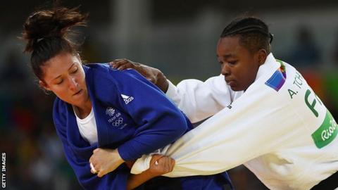 Audrey Tcheumeo of France competes with Natalie Powell of Great Britain
