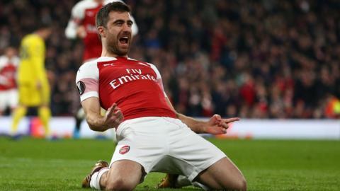 Arsenal's Sokratis slides on his knees to celebrate scoring