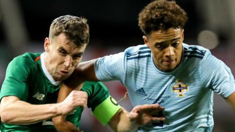 Republic of Ireland skipper Seamus Coleman competes against Northern Ireland defender Jamal Lewis