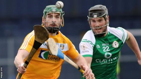 Antrim's Conor McCann attempts to burst away from London's Paul Euleck