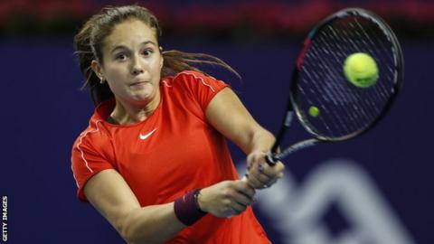 Daria Kasatkina plays a shot