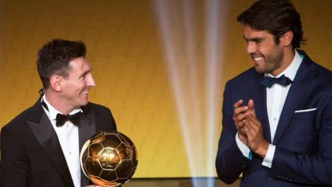 Lionel Messi receives the award from former winner Kaka