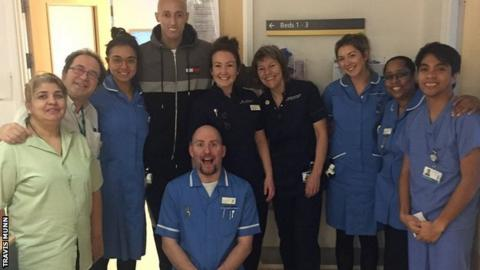 Travis Munn with staff at the London Royal Free Hospital