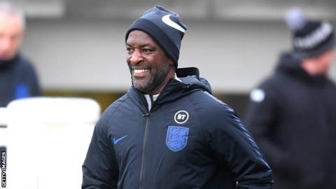 England coach Chris Powell smiles during a training session