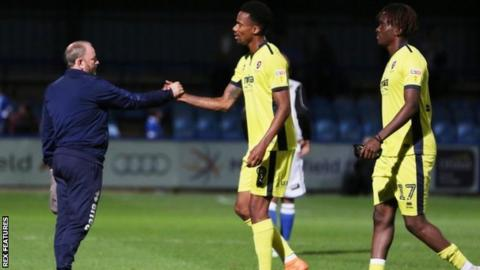 Gary Johnson congratulates goal scorer Manny Duku at the final whistle after taking charge for what proved to be his final game against Macclesfield at Moss Rose
