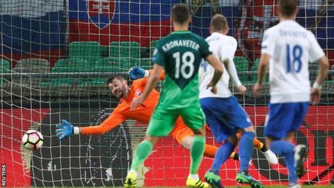 Slovenia's Rok Kronaveter scores against Slovakia