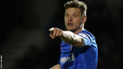 Ben Nugent in action for Gillingham