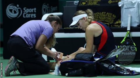 Caroline Wozniacki receives medical attention