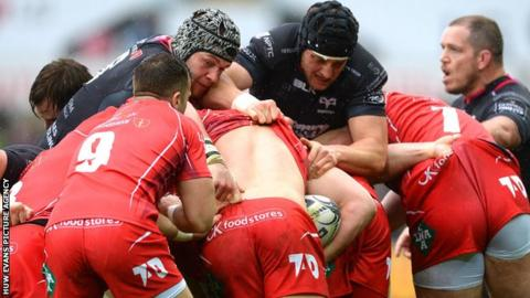 Scarlets and Ospreys get to grips with each other during a Pro12 match
