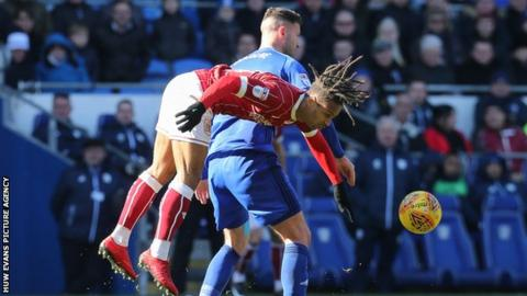 Bobby Reid and Gary Madine challenge for the ball in the air