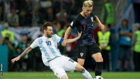Ivan Rakitic tackles Barcelona club mate Lionel Messi as Croatia beat Argentina in the World Cup