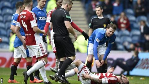 Referee John Beaton yellow carded Rangers striker Joe Garner for a wild challenge on Hamilton's Dougie Imrie