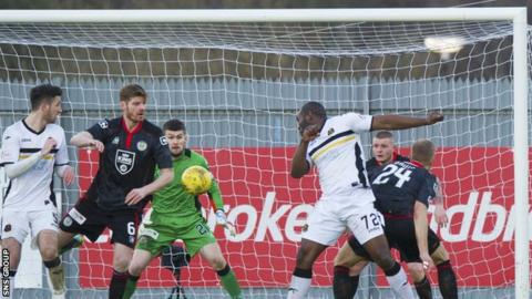 Christian Nade levels for Dumbarton to make it 1-1