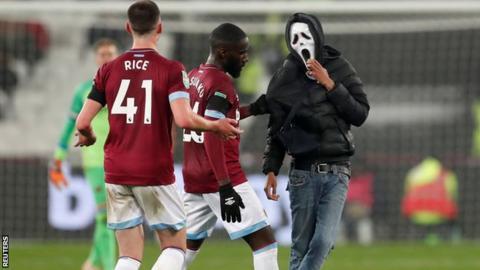 West Ham pitch invader