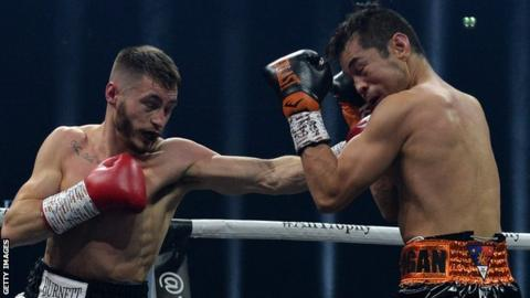 Ryan Burnett lands a punch on Nonito Donaire before a sustaining a fight-ending back injury