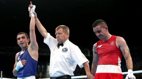 Azerbaijan's Albert Selimov is declared the winner of the Olympic lightweight bout against Ireland's David Oliver Joyce