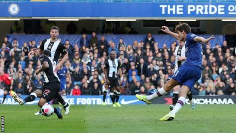 Marcos Alonso (right) scores