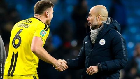 Ben Turner shaking hands with Manchester City manager Pep Guardiola