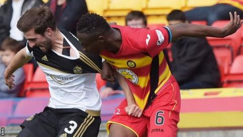 Graeme Shinnie and Abdul Osman