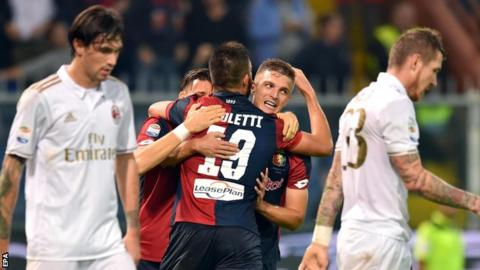 Genoa celebrate goal against Ac Milan