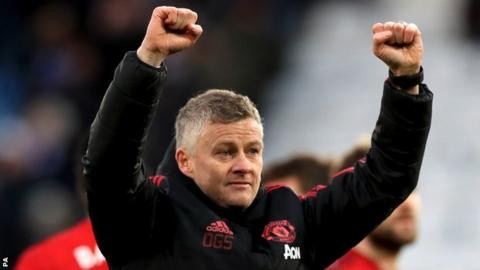 Manchester United interim boss Ole Gunnar Solskjaer raises both fists in celebration after his side beat Leicester
