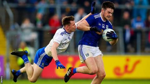 Monaghan defender Karl O'Connell takes to the air in a bid to stop Thomas Galligan