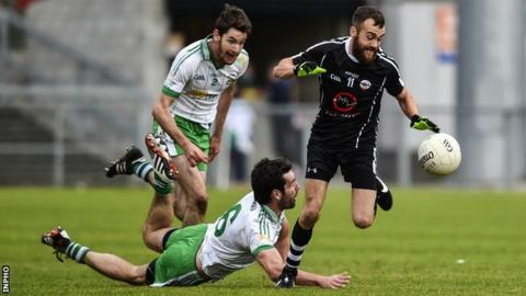 Burren's Jamie McGovern and Kevin McKernan battle with Kilcoo's Conor Laverty in the 2014 Down final