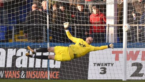 Goalkeeper Scott Loach of Hartlepool United makes a great early save against Wrexham