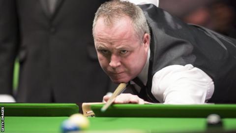 John Higgins plays a shot at the recent UK Championship