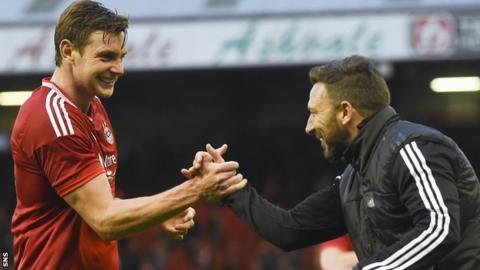 Aberdeen defender Ash Taylor and manager Derek McInnes celebrate