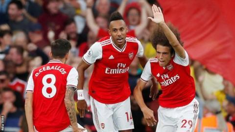 Matteo Guendouzi celebrates with his Arsenal team-mates