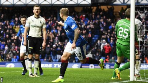 Martyn Waghorn turns away to celebrate Rangers scoring the opening goal