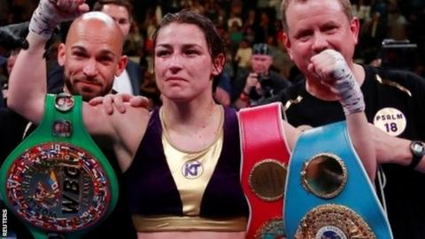 Katie Taylor with world title belts