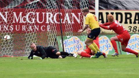 Dungannon Swifts midfielder Matthew Hazley hits the Portadown net to make it 1-1 at Shamrock Park