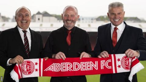 Atlanta United president Darren Eales, outgoing Aberdeen chairman Stewart Milne and incoming chairman Dave Cormack