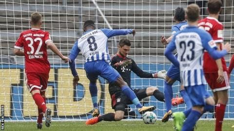Hertha's Salomon Kalou (C) equalises for the hosts as Bayern's impressive first half was undone in Berlin