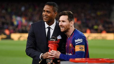 Patrick Kluivert and Lionel Messi