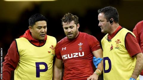 Leigh Halfpenny is led off the field after being concussed during Wales' 9-6 win against Australia