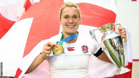 Burford poses with the World Cup trophy and her medal