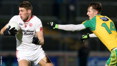 Tyrone's Padraig McNulty turns away from Donegal's Jason McGee