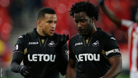 Martin Olsson talks to Swansea goal-scorer Wilfried Bony during the loss at Stoke