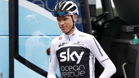 Team Sky rider Chris Froome steps off the team bus before a training session