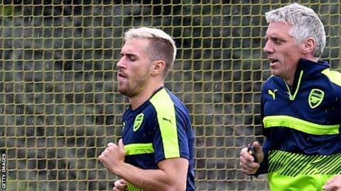 Aaron Ramsey (left) with Arsenal's assistant fitness coach Craig Gant
