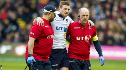 Finn Russell is taken off injured in Scotland's win over France