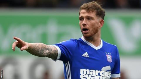 Joe Garner points towards an Ipswich team-mate