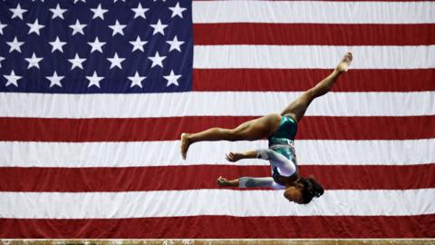 Kansas City, United States, 9 August: Simone Biles competes on the balance beam during the women's competition of the US Gymnastics Championships at the Sprint Center. (Photo by Jamie Squire/Getty Images)